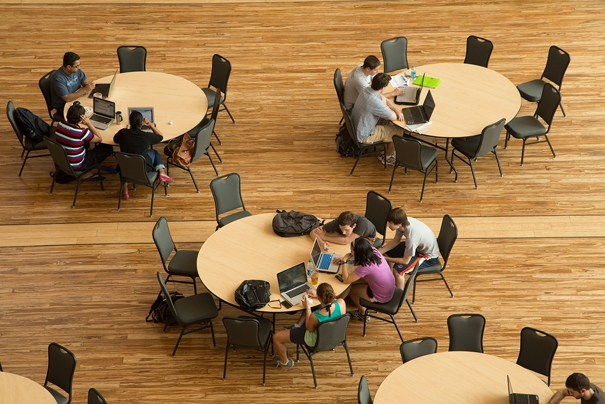 (4) Students study in the Business Instructional Facility Atrium.